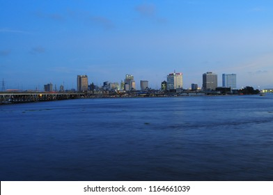 Twilight View of Central Business District, Lagos Island as seen across the Lagoon from Ijora, Lagos, Nigeria.