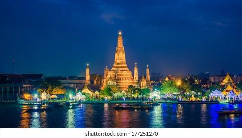 Twilight view Pra Prang of Wat Arun Temple, Famous Thai temple across Chao Phraya River during sunset, Bangkok, Thailand