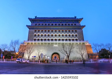 Twilight view of the Zhengyangmen Gate (colloqually known as Qianmen Gate) guarding the south entrance to the Forbidden City in Beijing, China.