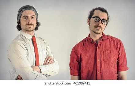 Twin adult men with beards take serious portrait together