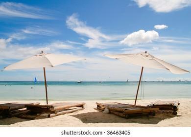 twin beach umbrellas facing the boracay beach front