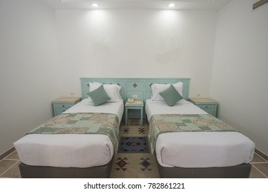 Twin beds bed in suite of a luxury hotel room with bedside tables