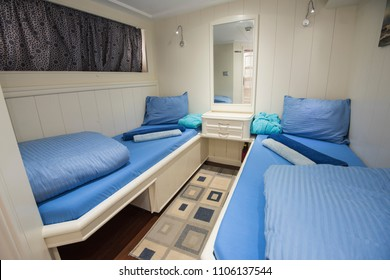 Twin beds in cabin of a luxury private motor yacht
