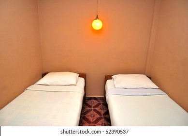 Twin beds neatly done up in a hotel room. Suitable for concepts such as travel, tourism, vacation and holiday.