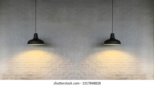 Twin black fixtures hank from ceiling with white brick wall background.