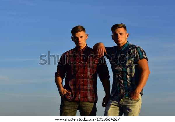 Twin brothers man outdoor in sunset, relations. twin men, friendship, family.