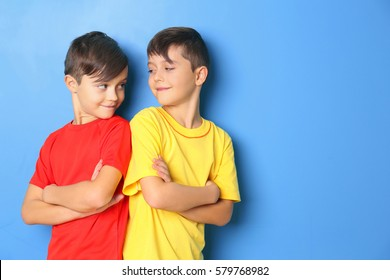 Twin brothers on blue background