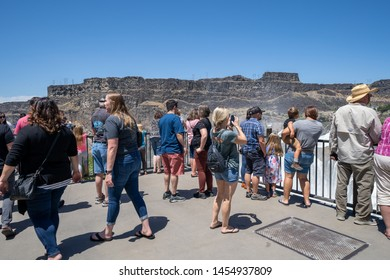 Twin Falls, Idaho - June 30, 2019: Crowds of visitors hang out at the viewing platform for Shoshone Falls, a large waterfall in a state park