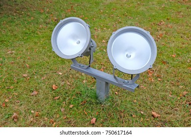 twin floodlights on the lawn to illuminate the facade of the building in the Park