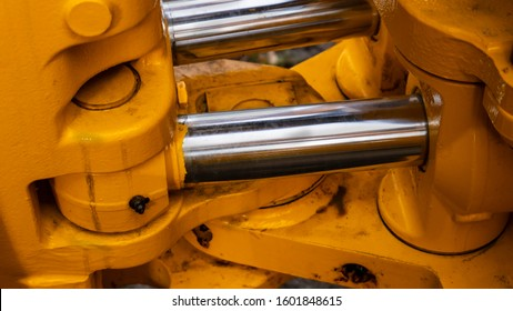 twin hydraulic cylinder detail on a new construction tractor