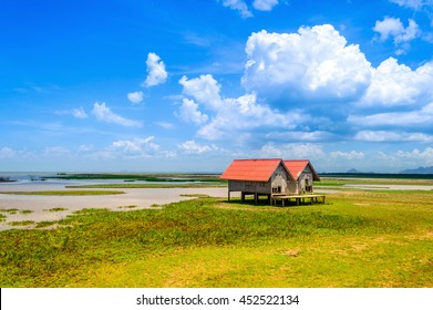 Twin old house at seashore between songkhla and phatthalung province, south of thailand.