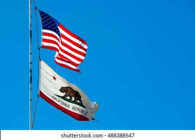 Twin Peaks, USA - 16th August, 2015: The USA and California state flags on Strawberry Peak near Twin Peaks, California, USA
