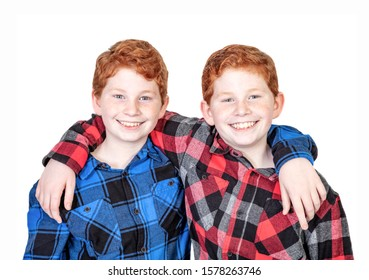 Twin redheaed boys in check shirts isolated on white background