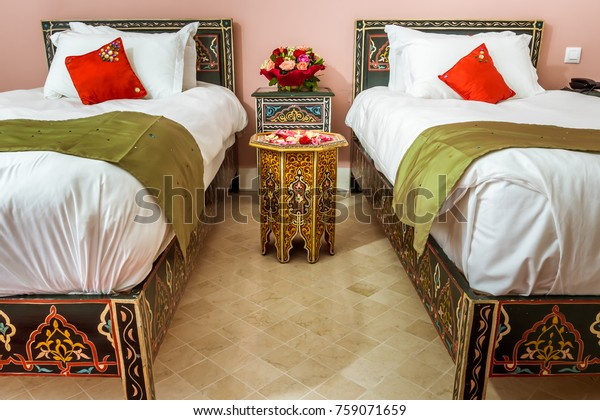 Twin room decorated in Moroccan style