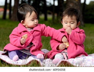 Twin sisters eating snack