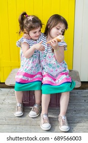 Twin sisters think about sharing an ice cream but one is not happy!