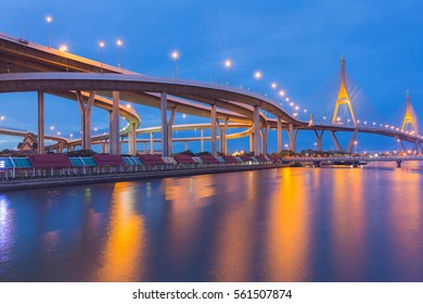 Twin Suspension bridge over Bangkok city river with twilight blue sky background, Thailand