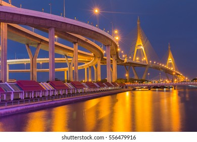 Twin suspension bridge with reflection lights with clear twilight sky background