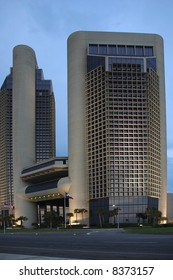 Twin towers of the modern office complex dominate the skyline.