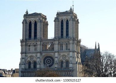 The twin towers of Notre-Dame cathedral rise above the River Seiine in Paris, France