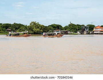 Twin tugboat is towing the freight boat at the Chao Phraya river to the northern province in Thailand.