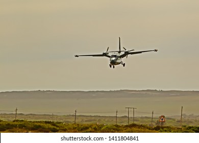 Twin-engine pusher propeller  aircraft approaching landing strip in Western Cape, South Africa