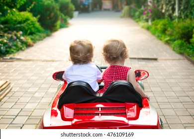 twins go to the red car