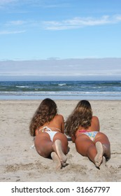 twins looking the sea in the beach