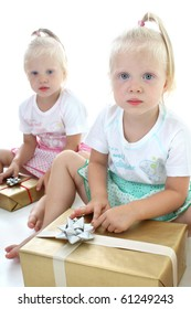 twins packing presents over white