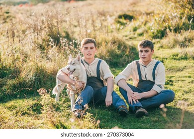 Twins take a walk with the dogs Huskies