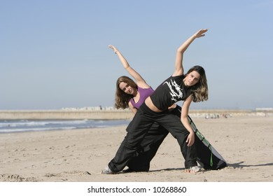 twins working out in the beach
