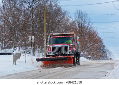 TWINSBURG, OH - DECEMBER 31, 2017: A city snowplow clears a residential street after a recent winter storm blew through northeast Ohio.
