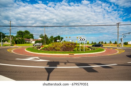 TWINSBURG, OH - JUNE 24, 2017: Vehicles navigate a newly constructed traffic roundabout in this northeast Ohio suburb.