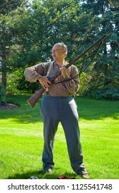 TWINSBURG, OH - JUNE 30, 2018: A reenactor demonstrates the use of a Civil War era rifle at an all-day history event at the Twinsburg Public Library