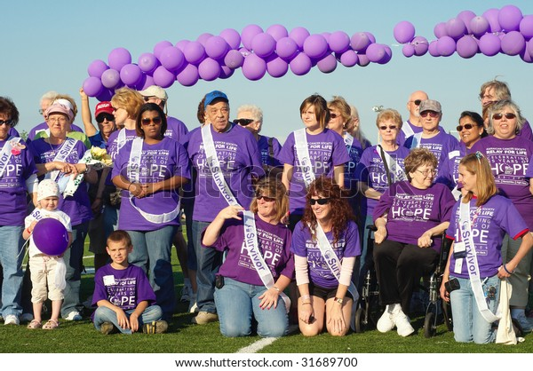 TWINSBURG, OH - June 5: Cancer survivors are honored at Relay for Life, an annual fundraising event sponsored by the American Cancer Society, June 5, 2009, in Twinsburg, Ohio.