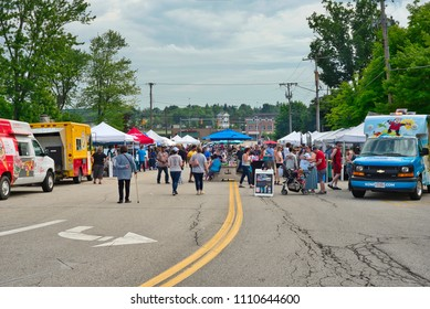 TWINSBURG, OH - JUNE 9, 2018: Visitors gather in front of food trucks and vendor booths for A Taste of Twinsburg, an outdoor culinary and arts festival held on the town square.