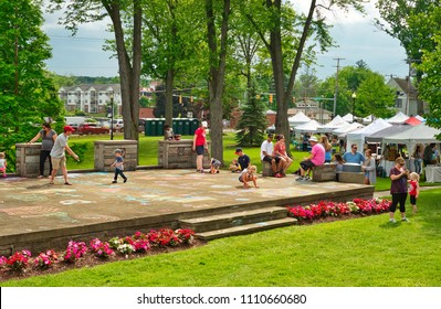 TWINSBURG, OH - JUNE 9, 2018: Children draw chalk art on a concert stage at A Taste of Twinsburg, an outdoor culinary and arts festival held one Saturday in summer on the town square.