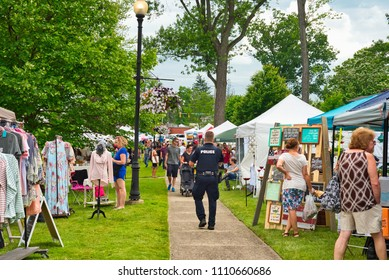 TWINSBURG, OH - JUNE 9, 2018: Visitors stroll between vendor booths for A Taste of Twinsburg, an outdoor culinary and arts festival held one Saturday in summer on the town square.
