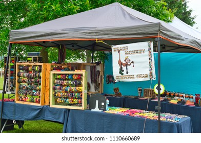 TWINSBURG, OH - JUNE 9, 2018: Colorful belts and bracelets are on display at a vendor booth at A Taste of Twinsburg, a culinary and arts and crafts festival held in summer on the town square.