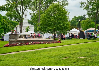 TWINSBURG, OH - JUNE 9, 2018: An outdoor concert stage serves as a play area at A Taste of Twinsburg, an outdoor culinary and arts festival held one Saturday in summer on the town square.