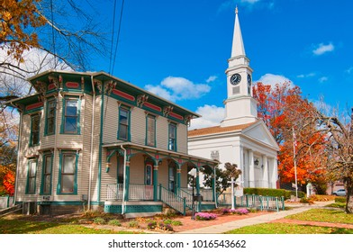 TWINSBURG, OH - OCTOBER 25, 2015: The Twinsburg Chamber of Commerce and the First Congregational Church (UCC) anchor the west side of the downtown square and are beloved landmarks.