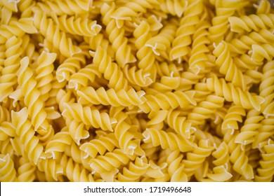 twirl pastas. auger pasta shot from top. spiral pasta.