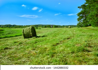 Twisted haystack on field. Haystack farmland field panorama. Haystack agrisulture farm field view