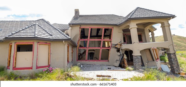 Twisted house falls to the ground as the earth shifts