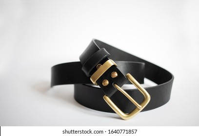 twisted man leather belt on a white background