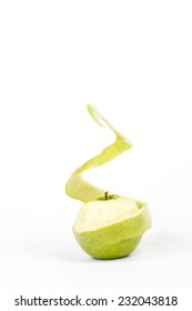 twisted peel of green apple on white background