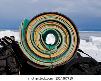 Сolored twisted rugs for tourism on a snow background