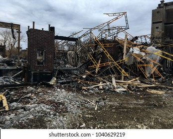 Twisted scaffolding and debris in the burnt aftermath of a building fire in Streetsville, Mississauga, Canada that occurred March 2, 2018.