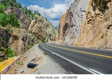 A Twisty Mountain Road and Cloudy Sky