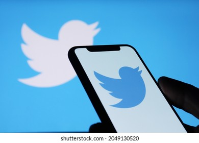Twitter application on phone screen and twitter logo background on computer screen - Chiang Mai, Thailand, September 26, 2021